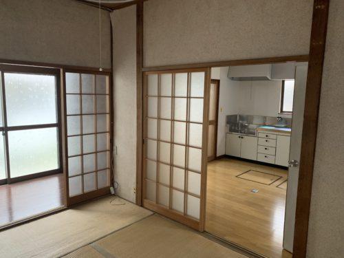 広島市南区翠5丁目の戸建賃貸の和室6畳・リビングの写真
